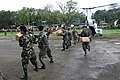 US Navy 060219-M-8084P-004 Members of the Philippine Army help U.S. Marines and Sailors, Feb. 19, unload meals ready to eat from a CH-46E Sea Knight helicopter as part of the relief effort being conducted at the request of the.jpg