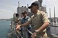US Navy 060520-N-9851B-012 Philippines Navy Lt. Edwin Nera and Indonesian Navy Maj. Ardiansyah Mursit stand on the bridge wing of amphibious dock landing ship USS Tortuga (LSD 46) as the ship gets underway.jpg