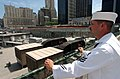 US Navy 060525-N-4936C-007 Engineman 1st Class Greg Fogle looks out over the World Trade Center Ground Zero site.jpg