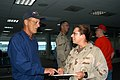 US Navy 060910-N-1625W-002 Builder 2nd Class Karen Testa assigned to Naval Mobile Construction Battalion One Eight (NMCB-18) talks with her former high school teacher.jpg