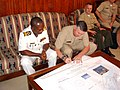 US Navy 070124-N-0000S-054 Director, Navy Europe-Africa Policy, Resources and Strategy, Rear Adm. Phil Greene and Commander, Ghana Eastern Naval Command, Commodore M. Quashie, sign updated navigation charts at a ceremony.jpg