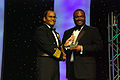 US Navy 070217-N-5608F-002 U.S. Fleet Forces Command Deputy Commander, Vice Adm. Melvin G. Williams Jr. presents the Deans Award to NAVAIR Aerospace Engineer Reggie White during the 21st Annual Black Engineer of the Year Awards.jpg