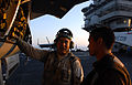 US Navy 070402-N-3659B-136 Aviation Electronics Technician 2nd Class Christopher Scott explains some aircraft inspection procedures to Aviation Machinist's Mate Airman Michael Baluyut.jpg