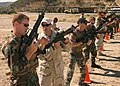 US Navy 070403-N-3901L-229 Explosive Ordinance Disposal First Class Jeffery Shultz shows trainees the proper methods of handling the M-4 machine gun at the South Bay Rolton Gun Club.jpg