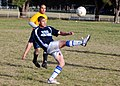 US Navy 070512-N-4021H-062 Boatswain Mate 2nd Class Gaston Garcia, a member of USS Pearl Harbor (LSD 52) Soccer Team, clears a ball away from the net during a tournament.jpg