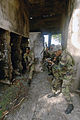 US Navy 070925-N-0989H-455 Members of the Jamaica Defense Force conduct Close Quarters Battle and room clearing drills with U.S. Marines assigned to a mobile training team during small unit training.jpg