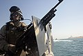 US Navy 080705-M-1391M-001 Gunner's Mate Seaman Jose Caro, assigned to Riverine Squadron (RIVRON ) 3, watches the open water while conducting a security patrol.jpg