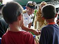 US Navy 080709-N-4431B-971 Rear Adm. Nora W. Tyson, commander of Logistics Group Western Pacific, greets children at Sekolah Kebangsaan Kijal Elementary School.jpg