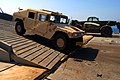 US Navy 080725-N-3038W-332 Soldiers assigned to the 45th Sustainment Brigade and the 3rd Brigade Combat Team of the 25th Infantry Division offload supplies and equipment.jpg