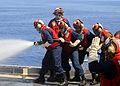 US Navy 080911-N-1082Z-037 Sailors from the flight deck firefighting team practice firefighting techniques.jpg