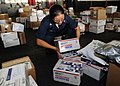 US Navy 090108-N-2562S-004 Interior Communications Electrician 3rd Class Erica Tapia picks up a load of.jpg