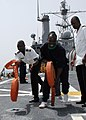 US Navy 090213-N-1655H-237 Africa Partnership Station embarked trainees unroll fire hoses aboard the amphibious transport dock ship USS Nashville (LPD 13) during damage control training.jpg
