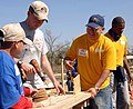 US Navy 090307-N-8816D-308 Seabees help local volunteers construct a 4,300 square foot playground at Pass Christian Elementary School in Pass Christian, Miss.jpg