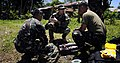 US Navy 090321-N-7130B-155 Chief Explosive Ordnance Disposal Technician Kenneth Simpson, assigned to Joint Special Operations Task Force-Philippines Explosive Ordnance Disposal Task Unit, teaches explosive tool technique.jpg