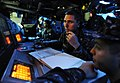 US Navy 090619-N-5345W-076 Operations Specialist 2nd Class Timothy Cantrell monitors a status board while operating as sensor supervisor in the combat information center aboard the amphibious dock landing ship USS Fort McHenry.jpg