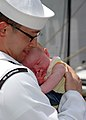 US Navy 090805-N-5292M-957 Information Systems Technician 2nd Class Michael Cao, assigned to the guided-missile frigate USS Kauffman (FFG 59), holds his one-month-old daughter for the first time.jpg