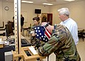 US Navy 091014-N-4981W-144 Instructors assigned to the Naval Construction Training Center give an interactive welding lesson to Gulfport Mayor George Schlogel as he tours the Naval Construction Battalion Center in Gulfport, Mis.jpg