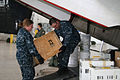 US Navy 100114-N-9402B-003 Sailors load boxes onto a C-2A Greyhound transport aircraft headed for Naval Station Guantanamo Bay, Cuba.jpg
