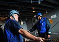 US Navy 100204-N-2953W-099 Boatswain's Mate Seaman Marcus Dronet, from Lake Charles, La., assigned to the Nimitz-class aircraft carrier USS Carl Vinson (CVN 70), heaves a line during a replenishment-at-sea.jpg