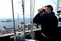 US Navy 100318-N-4275C-485 Senior Chief Quartermaster Johnny Myers observes a replenishment at sea between the aircraft carrier USS Carl Vinson (CVN 70).jpg