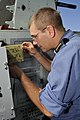 US Navy 100708-O-0000S-081 Master Seaman Shawn Zweers troubleshoots the Close-In Weapons System aboard HMCS Algonquin (DD 283).jpg