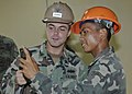 US Navy 101018-N-7783B-022 Construction Electrician 3rd Class John O'Conner, left, assigned to Naval Mobile Construction Battalion (NMCB) 11, share.jpg