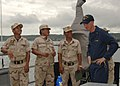 US Navy 101028-N-9156C-008 Royal Cambodian Navy officers discuss the weapons systems aboard the guided-missile frigate USS Commelin (FFG 37) ship's.jpg