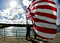 US Navy 110530-N-CO162-071 Boatswain's Mate Seaman Apprentice Devon Nelson and Seaman Apprentice Francessca Torres hoist the national ensign aboard.jpg