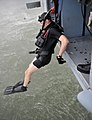 US Navy 110921-N-ZZ999-181 Aviation Warfare Systems Operator 3rd Class Michael Cox jumps from the helicopter duAviation Warfare Systems Operator 3r.jpg