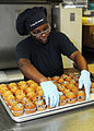 US Navy 110926-N-VA840-013 Logistics Specialist Seaman Jessica R. Johnson prepares muffins in the bakeshop aboard USS George H.W. Bush (CVN 77).jpg