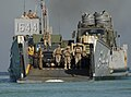 US Navy 111114-N-KA046-056 Sailors and Marines disembark from a landing craft utility (LCU) assigned to the amphibious dock landing ship USS Whidb.jpg