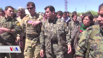 Rojda Felat - Felat (right) with YPG and US officials at the site of the April 2017 Turkish airstrikes in al-Hasakah Governorate.