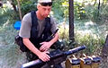 Ukrainian soldier checking his grenade launcher in Donbass.jpg