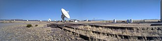Very Large Array - The cross rail track structure of the VLA, including an empty antenna mount station on the right (the three concrete piers that the antenna's triangular base mounts to)