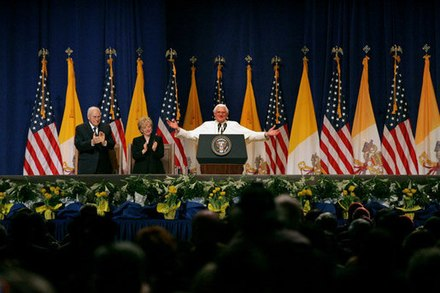 Pope Benedict XVI, Vice President Dick Cheney and Mrs. Lynne Cheney at a farewell ceremony for the Pope at John F. Kennedy International Airport in New York. Vice President Cheney Pope Benedict XVI on stage.jpg