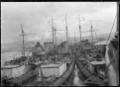 View of the stern of three American warships moored at Dunedin Wharf. ATLIB 294394.png