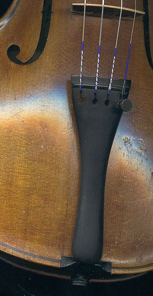Tailpiece - This violin tailpiece has one fine tuner on the E string.