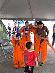 Visitors Wearing Flight Suit in Tent of ROCAFA T-34C Photographing Area 20170812.jpg
