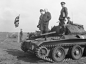 27th Armoured Brigade - Winston Churchill stands on a Covenanter tank of the 4th/7th Royal Dragoon Guards to take the salute at an inspection of the 9th Armoured Division near Newmarket, Suffolk, 16 May 1942. Also pictured is Major General Brian Horrocks, the division commander.