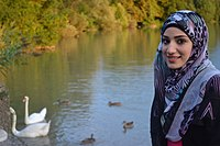 Woman standing in front of river with swans.jpg