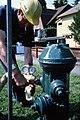 Worker testing water pressure on hydrant, 1990 (39378496400).jpg