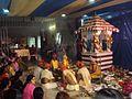 Worshiping Ardhanarishwar Shiva-lingam at Damodareshwar Shiva Temple.jpg