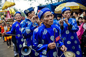 Culture of Vietnam - A group of men play traditional musical instruments at a village festival in Bắc Ninh Province.