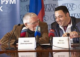 Armen Dzhigarkhanyan - Dzhigarkhanyan (left) at an ITAR-TASS press-conference, 2012