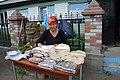 Сай Хонаш Женщина торгует кедровыми орехами.jpg