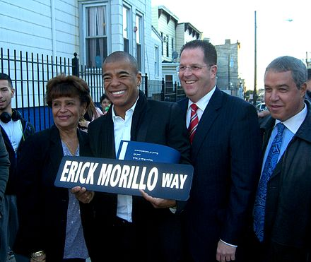 Morillo and his mother, Elisa, at the October 12, 2012 ceremony in Union City, New Jersey in which the portion of Bergenline Avenue on which he grew up was dedicated in his honor. To the right of Morillo are Mayor Brian P. Stack and Commissioner Lucio P. Fernandez. 10.11.12ErickMorilloByLuigiNovi51.jpg