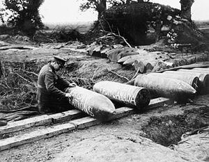 Military history of Canada during World War I - A Canadian gunner chalking messages on to 15-inch howitzer shells in September 1916