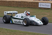 Sideview of a white Williams racing car during a presentation run