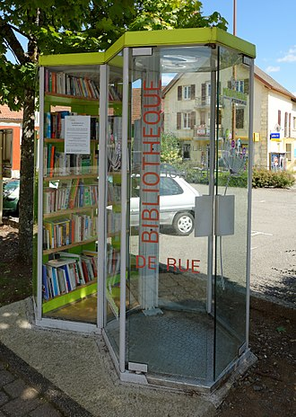 Public bookcase - Street library, made with a telephone booth, at Giromagny, France.