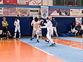 2nd Leonidas Pirgos Fencing Tournament. Matthew Baker lunges the parry of Vasilios Papadopoulos.jpg